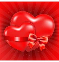 Two Red Hearts With Red Bow And Sunburst vector image