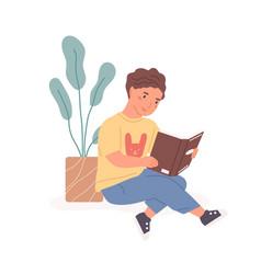 Happy boy sitting with open book in hands vector