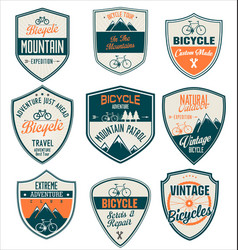 bicycle retro blue and orange vintage badge vector image