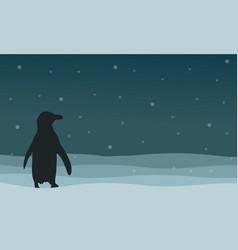Silhouette of penguin on hill landscape vector