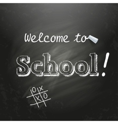Welcome to School written on a black chalkboard vector image