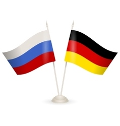 Table stand with flags of Russia and Germany vector image