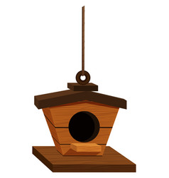 Wooden birdhouse hanging on rope vector