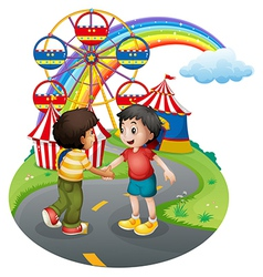 Boys handshaking in front carnival vector