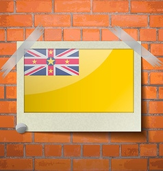 Flags Niue scotch taped to a red brick wall vector