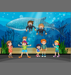 Kids looking at whale and divers in aquarium vector