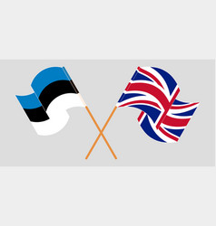 Crossed and waving flags estonia and uk vector