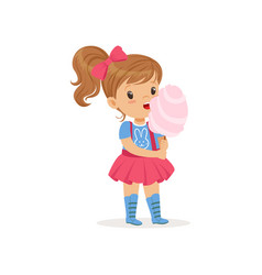 Lovely toddler kid eating sweet cotton candy on vector