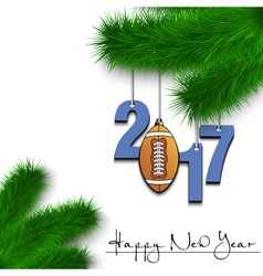 Football ball and 2017 on a Christmas tree branch vector image