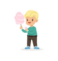 Little blond boy with sweet cotton candy cartoon vector