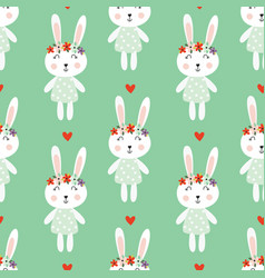 seamless pattern with cute rabbits and flowers vector image