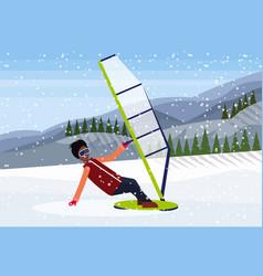 man windboarder windsurfing on snow mountains fir vector image