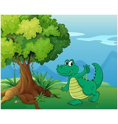 A crocodile near the tree vector image