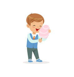 Cartoon cheerful boy eating sweet cotton candy on vector