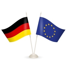 Table stand with flags of Germany and US vector image vector image