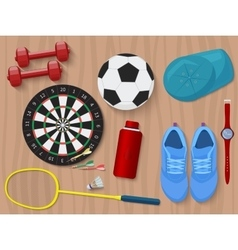 Sports equipment on wooden floor Shoes darts vector image vector image