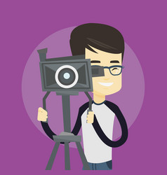 Cameraman with movie camera on tripod vector