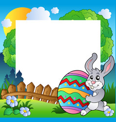 easter frame with bunny holding egg vector image