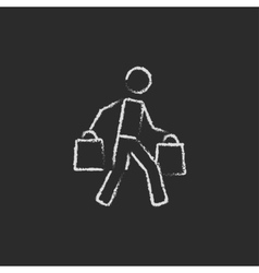 Man carrying shopping bags icon drawn in chalk vector image