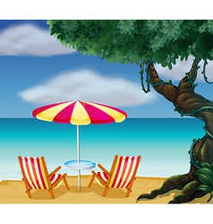 Two chairs with umbrella at beach vector