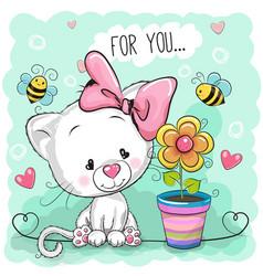 Cute cartoon kitten with flower vector