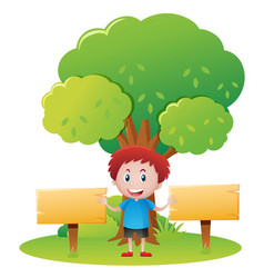 boy with two wooden signs in the park vector image