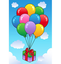 floating gift with cartoon balloons vector image