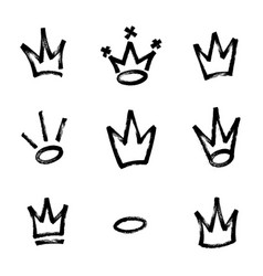 Graffiti crown set in black over white drawn by vector