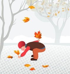 Little child collecting fallen leaves in a park vector image