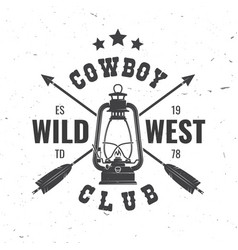 wild west badge with indian arrow and lantern vector image