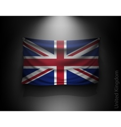waving flag United Kingdom on a dark wall vector image vector image