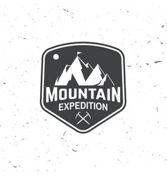 vintage typography design with ice ax and mountain vector image