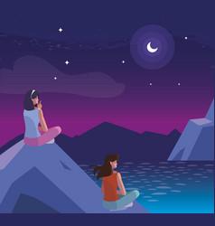 Women contemplating horizon in lake and mountains vector