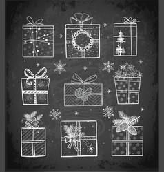 christmas gift boxes on blackboard background vector image vector image