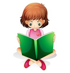 A young girl reading a green book vector image vector image