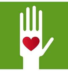 Heart in Hand on green background vector image vector image