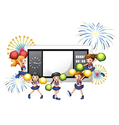 Cheerdancers with a scoreboard at the back vector image vector image