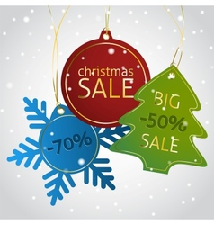 Christmas sale tags on a snowy background vector image