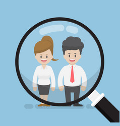 magnifying glass focused on businessman and vector image