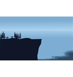 Silhouette of cliff in beach scenery vector image
