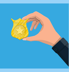 Police officer badge in hand vector