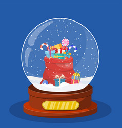 christmas snow globe with red bag vector image