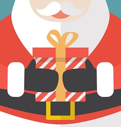 Santa Claus holding a Christmas gift vector image