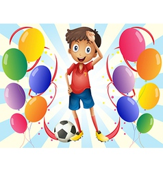 A soccer player in the middle of the balloons vector image