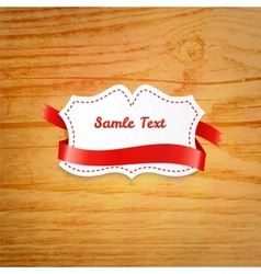 Label over wooden background vector image