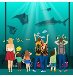 People watching underwater scenery in oceanarium vector