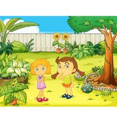 Girls in the garden vector image vector image