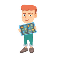 caucasian boy playing game on a tablet computer vector image