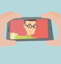 caucasian man making selfie vector image