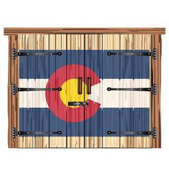 Closed barn door with colorado flag vector